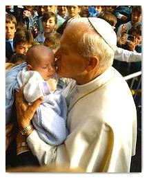 john-paul-ii-holding-child.jpg
